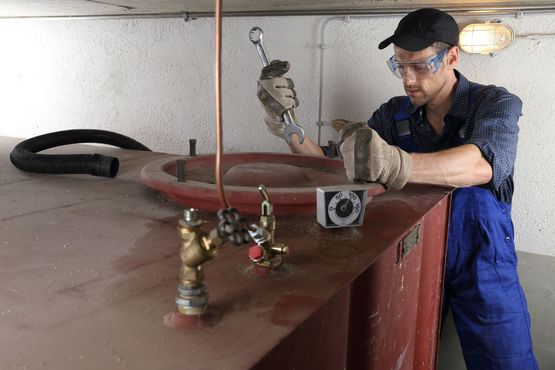 Man cleaning oil tank